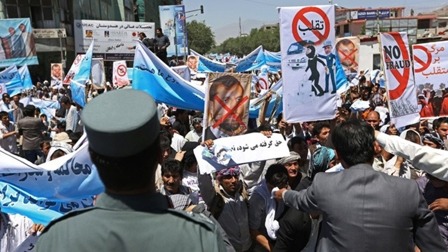 June 21, 2014: Supporters of presidential candidate Abdullah Abdullah shout slogans during a protest in Kabul, Afghanistan. Former Foreign Minister Abdullah, who is running against Ashraf Ghani Ahmadzai, a former finance minister, has accused electoral officials and others of trying to rig the June 14 vote against him. (AP Photo/Rahmat Gul)