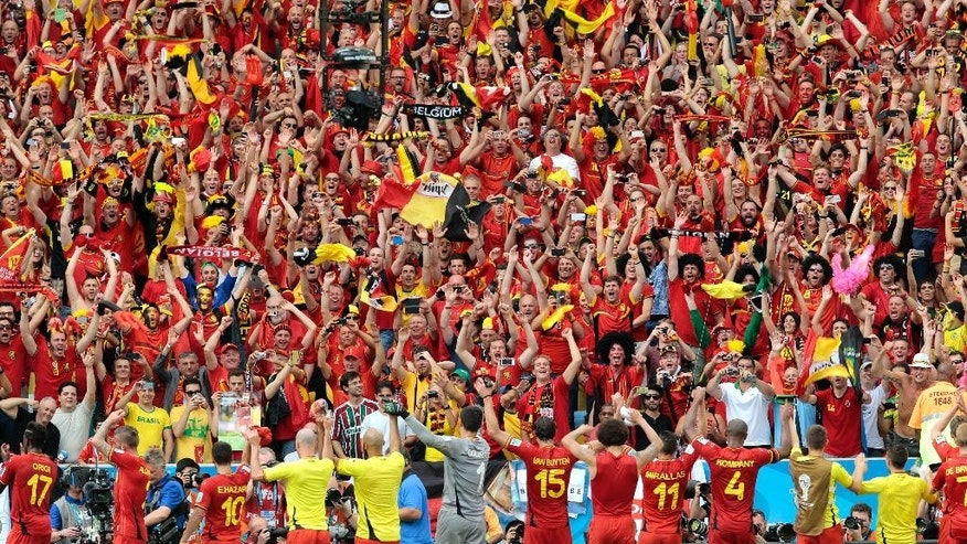 Belgian players celebrate with their supporters after the group H World Cup soccer match between Belgium and Russia at the Maracana Stadium in Rio de Janeiro, Brazil, Sunday, June 22, 2014. Belgium won the match 1-0. (AP Photo/Ivan Sekretarev)