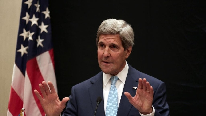 U.S. Secretary of State John Kerry speaks during a joint news conference with Egyptian Foreign Minister Sameh Shoukry following his meeting with Egyptian President Abdel-Fattah el-Sissi, Sunday, June 22, 2014, in Cairo, Egypt. (AP Photo/Maya Alleruzzo)