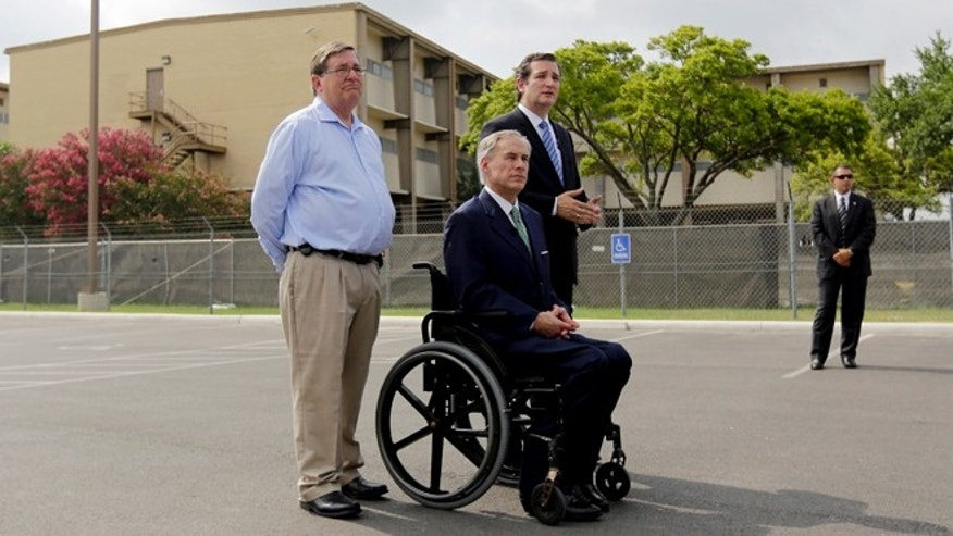 U.S. Sen. Ted Cruz, right, with U.S. Rep Michael Bachmann, left, and Attorney Gen. and Republican gubernatorial candidate Greg Abbott, center, talks to the media outside a temporary shelter for unaccompanied minors who have entered the country illegally at Lackland Air Force Base , Monday, June 23, 2014, in San Antonio.Cruz and Abbott are ramping up criticism of President Barack Obama for more than 52,000 unaccompanied minors who have poured across the southwestern border of the U.S. in recent months. (AP Photo/Eric Gay)