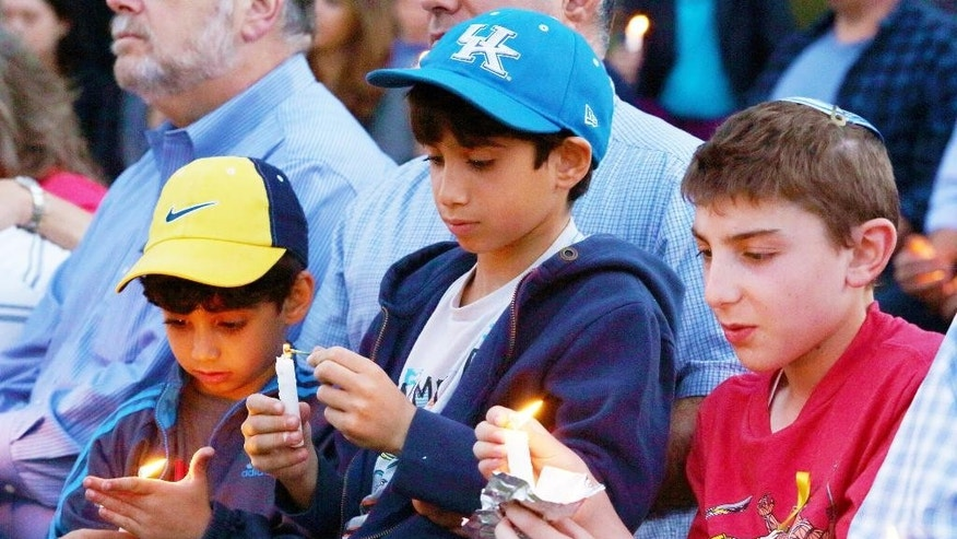 Young boys participate in an inter-faith community candle-light vigil in support of three Israeli students kidnapped by terrorists last Thursday night.  The kidnapped Israeli teens; Naftali Frenkel (16), Gilad Shaar (16), and Eyal Yifrach (19), were abducted from a hitchhiking point in the Gush Etzion area of the West Bank.  The community vigil was organized and sponsored by the Jewish Federation of Greater Los Angeles. (AP Photo/Joe Shalmoni)