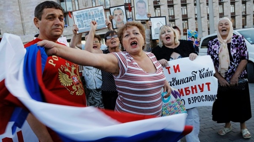 June 23, 2014: Pro-Russian demonstrators shout slogans in Donetsk, eastern Ukraine. (AP Photo/Dmitry Lovetsky)