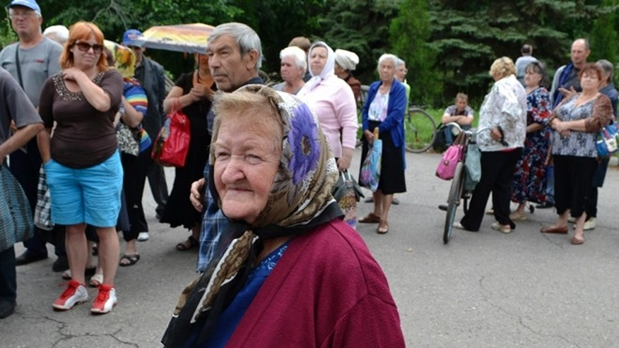 June 23, 2014: Local citizens lineup to get free food in besieged Slovyansk, eastern Ukraine. Insurgents promised Monday to honor a cease-fire declared by the Ukrainian president and engage in more talks to help resolve the conflict that has left hundreds dead in eastern Ukraine.