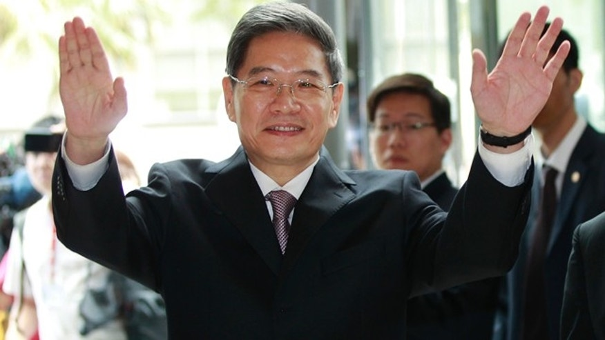 June 25, 2014: Zhang Zhijun, minister of Beijings Taiwan Affairs Office, waves at the airport hotel upon arrival in Taoyuan, Taiwan. China has sent Zhang, its first ever ministerial-level official to Taiwan for four days of meetings to rebuild ties with the self-ruled island that Beijing claims as its own, after mass protests in Taipei set back relations earlier this year. (AP Photo/Wally Santana)