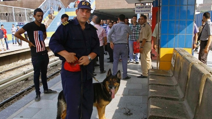 June 25, 2014: Egyptian security forces and civilians inspect damages after an explosion hit a subway station in Shubra el-Khemia northern Cairo, Egypt. Four minor explosions struck subway stations in Cairo on Wednesday, wounding two people and causing widespread panic among morning commuters, officials said.
