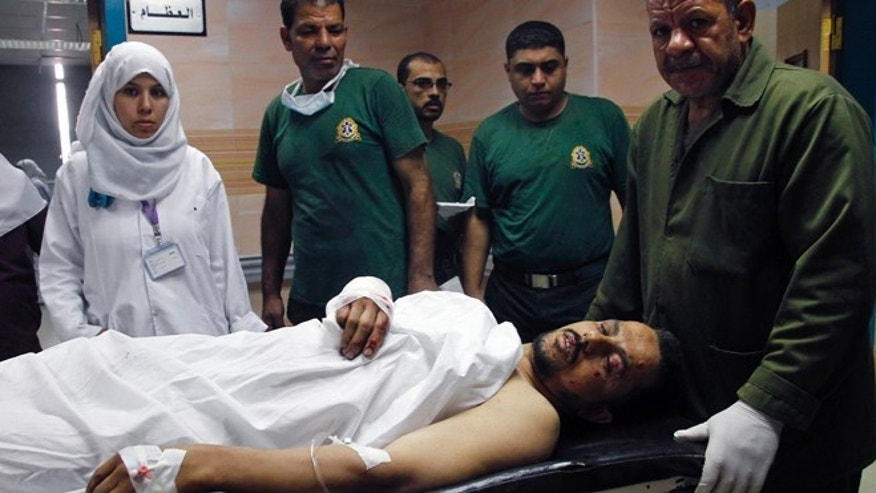 June 25, 2014: Nurses rush an injured man into a hospital following an explosion at a subway station, in Cairo, Egypt. Four minor explosions struck subway stations in Cairo on Wednesday, wounding many people and causing widespread panic among morning commuters, officials said.