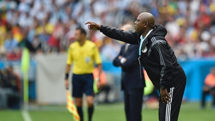 Nigeria's coach Stephen Keshi gives instructions to his players during the group F World Cup soccer match against Argentina at the Estadio Beira-Rio in Porto Alegre, Brazil, Wednesday, June 25, 2014. (AP Photo/Martin Meissner)