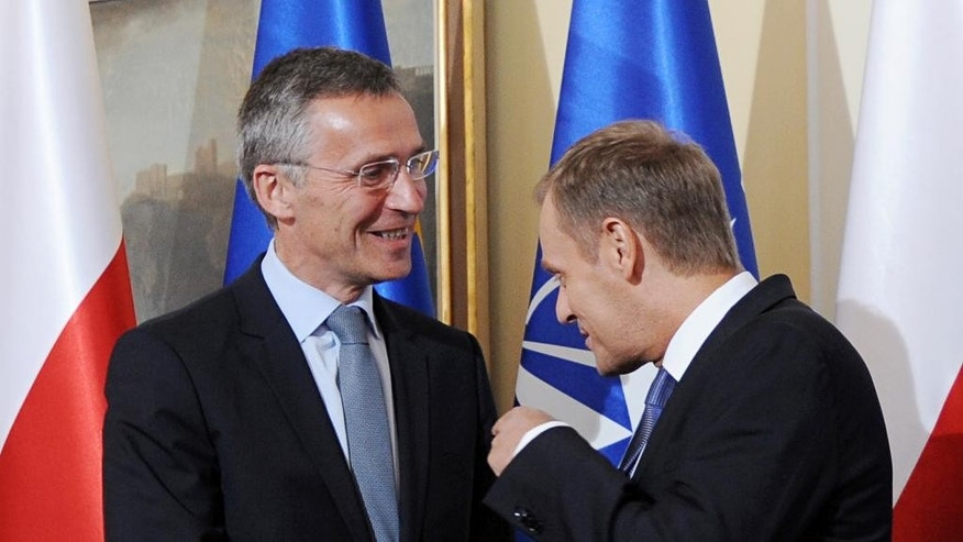 Polish Prime Minister Donald Tusk, right, gestures, as he meets NATO Secretary General designate Jens Stoltenberg, prior to talks in Warsaw, Poland, Wednesday, June 25, 2014. (AP Photo/Alik Keplicz)