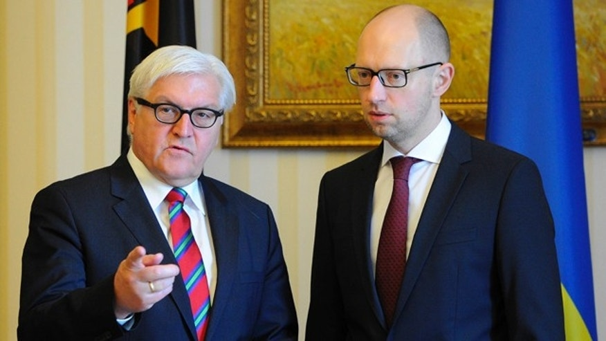 June 24, 2014: German Foreign Minister Frank-Walter Steinmeier, left, talks with Ukrainian Prime Minister Arseniy Yatsenyuk during a meeting in Kiev, Ukraine. (AP Photo/Andrew Kravchenko, Pool)