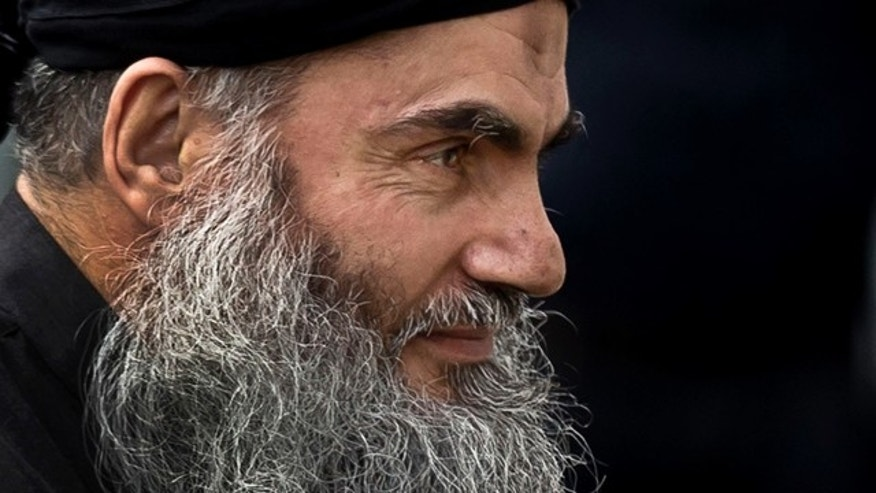 FILE - November 12, 2013: Radical Al Qaeda-linked preacher Abu Qatada arrives back to his residence in London after being freed from prison. A Jordanian military court has acquitted Abu Qatada of terror charges over a foiled 1999 plot to attack an American school in the Jordanian capital, Amman. (AP Photo/Matt Dunham, File)