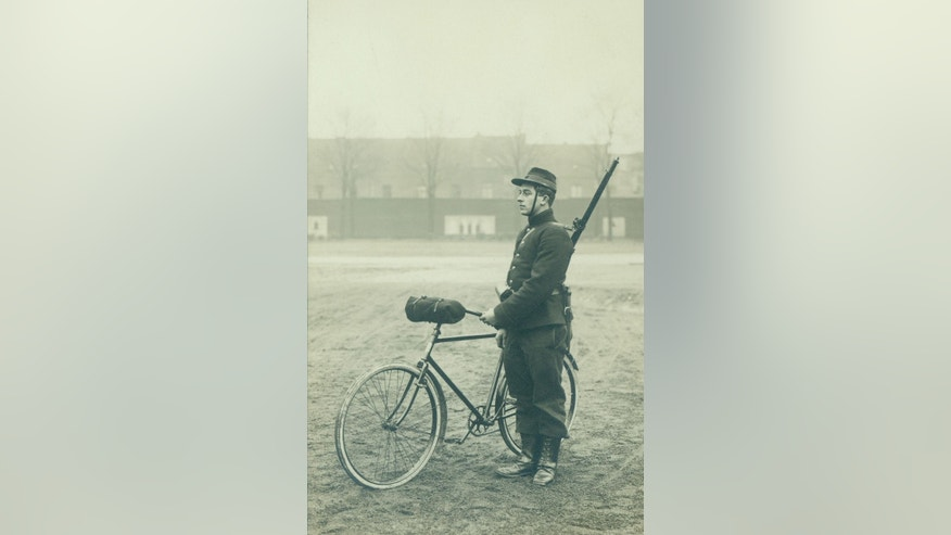 In this undated photo provided by the WielerMuseum Roeselare, a Belgian World War I soldier with his bicycle in Belgium during wartime. Late in the 19th century the Belgian Army took an interest in the newly emerging sport of cycling. A separate unit was created and came to be known as the Cyclist Riflemen. During World War I they played a key role in the Battle of Haelen in Belgium. The German Army nicknamed them the Black Devils, owing to their black outfits and hats, as well as their fast silent movements. (AP Photo/WielerMuseum)