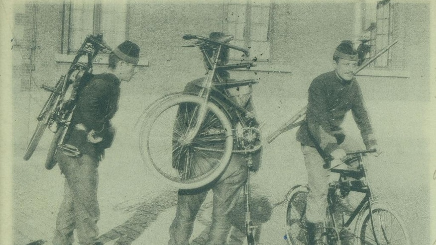 In this photo of an undated postcard provided by the WielerMuseum Roeselare, Belgian World War I soldiers with their foldable bicycles in Belgium during wartime. Late in the 19th century the Belgian Army took an interest in the newly emerging sport of cycling. A separate unit was created and came to be known as the Cyclist Riflemen. During World War I they played a key role in the Battle of Haelen in Belgium. The German Army nicknamed them the Black Devils, owing to their black outfits and hats, as well as their fast silent movements. (AP Photo/WielerMuseum)