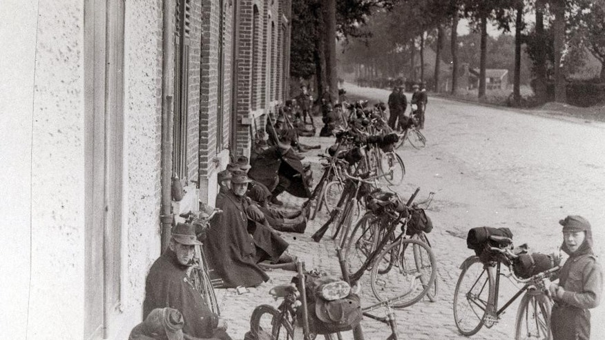 In this photo provided by the WielerMuseum Roeselare, an undated photo of Belgian World War I soldiers with their bicycles in Belgium during wartime. Late in the 19th century the Belgian Army took an interest in the newly emerging sport of cycling. A separate unit was created and came to be known as the Cyclist Riflemen. During World War I they played a key role in the Battle of Haelen in Belgium. The German Army nicknamed them the Black Devils, owing to their black outfits and hats, as well as their fast silent movements. (AP Photo/WielerMuseum)