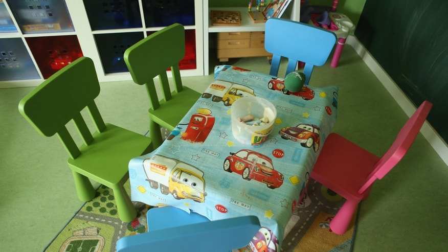 "BERLIN, GERMANY - OCTOBER 05:  Children's table and chairs stand in the playroom of the ""Jule"" facility for single parents in Marzahn-Hellersdorf district on October 5, 2012 in Berlin, Germany. The Jule project helps single parents by helping them to find jobs, job training and housing, advice on child development and day care in Marzahn-Hellersdorf, a district in east Berlin with high levels of unemployment and social problems. Currently 14 single mothers and one single father are participaring at Jule, which opened its doors in the spring of 2012.  (Photo by Sean Gallup/Getty Images)"