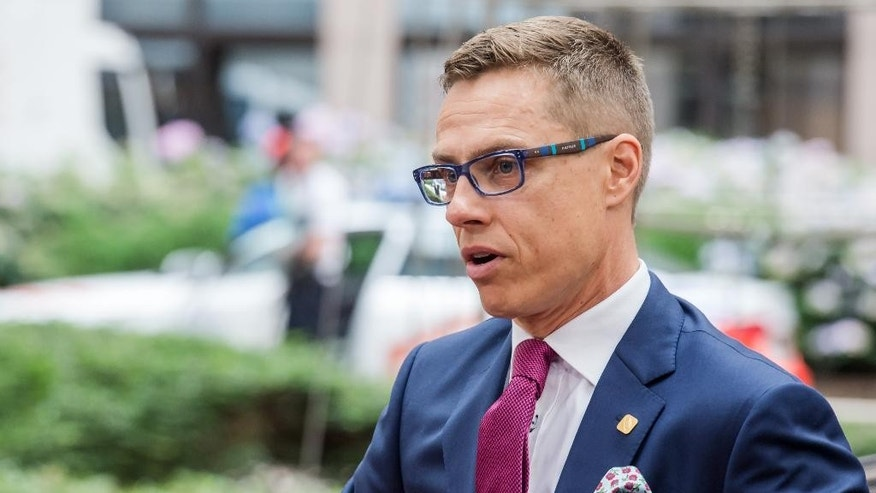 Finland's Prime Minister Alexander Stubb arrives for an EU summit in Brussels, Friday June 27, 2014.  European Union leaders are set to nominate former Luxembourg Prime Minister Jean-Claude Juncker to become the 28-nation bloc's new chief executive despite strong British opposition. The leaders at their summit Friday in Brusssels planned to elect Juncker with overwhelming majority as the candidate they will propose to the European Parliament. (AP Photo/Geert Vanden Wijngaert)