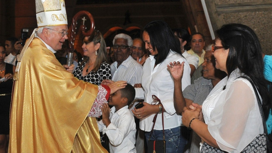 March 15, 2013 - FILE photo of Archbishop Josef Wesolowski, papal nuncio for the Dominican Republic, greeting people after a Mass in Santo Domingo, Dominican Republic. Wesolowski has been convicted by a church tribunal of sex abuse and has been defrocked.