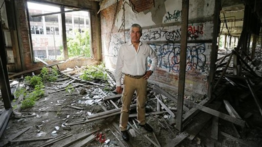 In a Friday, June 27, 2014 photo, Packard Plant owner Fernando Palazuelo stands in his proposed future office at the industrial site in Detroit. Palazuelo told The Associated Press on Friday that crews will be at the 40-acre eastside site Monday and that he plans to have an apartment for himself built there before the end of the year. The plant was built in the early 1900s. Car production ended in the 1950s, but its buildings were later used as warehouses and for other projects. It has been completely vacant for a number of years.  (AP Photo/Carlos Osorio)