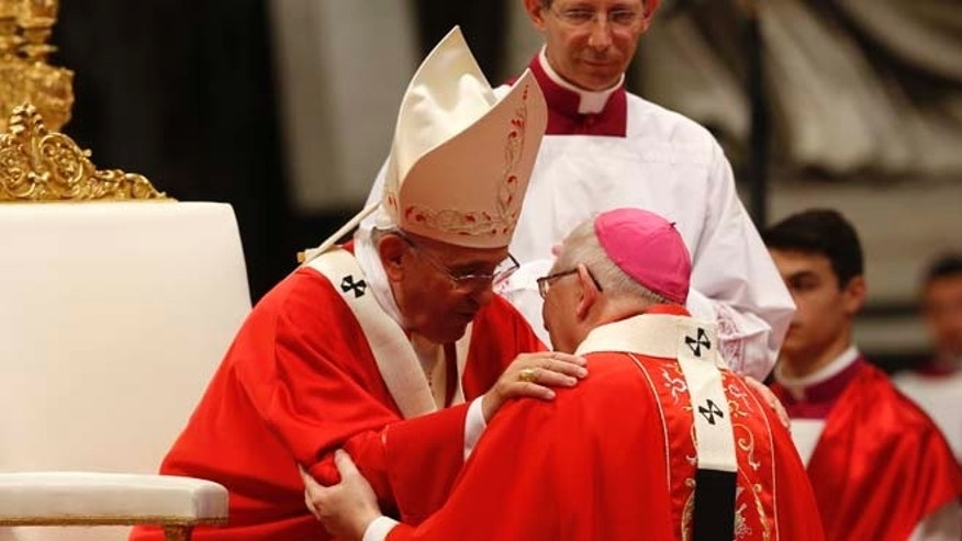 June 29, 2014: Pope Francis greets Monsignor Leonard Paul Blair, Archbishop of Hartford, Connecticut, after bestowing to him the Pallium, a woolen shawl symbolizing their bond to the pope, during a mass in St. Peter's Basilica, at the Vatican. (AP)
