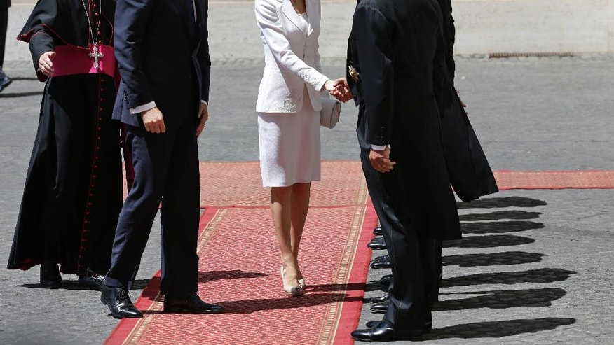 Father Georg Gaenswein, left, welcomes   King Felipe VI of Spain and and Queen Letizia of Spain, as they arrive at the Vatican to meet Pope Francis, Monday, June 30, 2014. (AP Photo/Alessandra Tarantino)