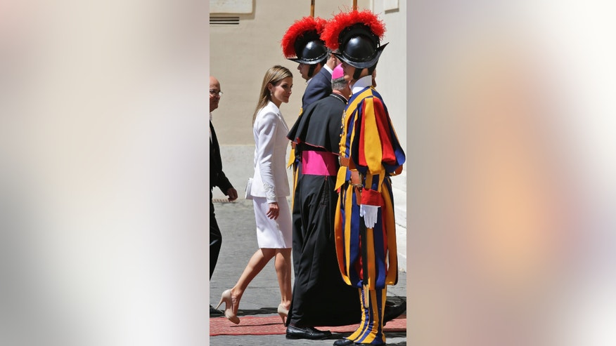 Queen Letizia of Spain looks at the Swiss Guards as she arrives at the Vatican to meet Pope Francis, Monday, June 30, 2014. (AP Photo/Alessandra Tarantino)