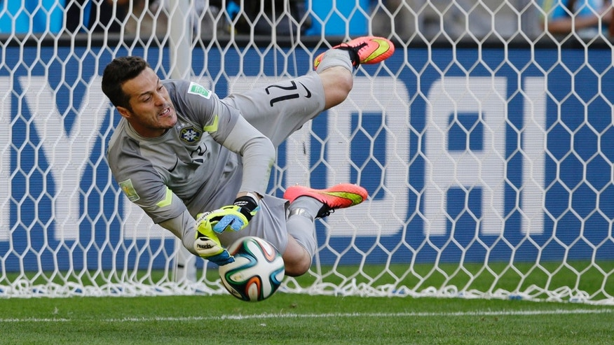 June 28, 2014 - Brazil's goalkeeper Julio Cesar makes a save during a penalty shootout during the World Cup match between Brazil and Chile,  Mineirao Stadium in Belo Horizonte, Brazil.