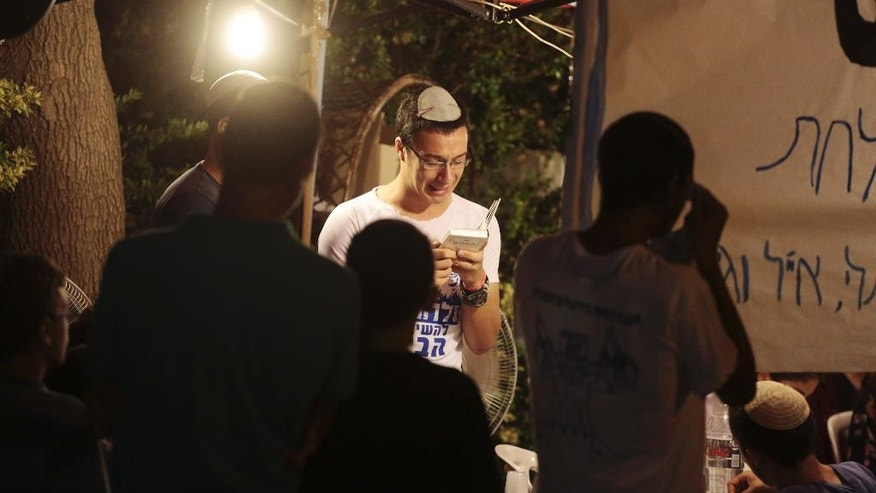 Friends and relatives of Naftali Fraenkel, 16, one of three missing teenagers, gather outside of his home after the announcement his body was found earlier today near the West Bank town of Hebron, at the West Bank Jewish settlement of Nof Ayalon, where the Fraenkel family lives, Monday, June 30, 2014. The Israeli military found the bodies of three missing teenagers on Monday, just over two weeks after they were abducted in the West Bank, allegedly by Hamas militants. The grisly discovery culminated a feverish search that led to Israel's largest ground operation in the Palestinian territory in nearly a decade and raised fears of renewed fighting with Hamas. Israeli Prime Minister Benjamin Netanyahu was huddling with his Security Cabinet late Monday to discuss a response. (AP Photo/Olivier Fitoussi)ISRAEL OUT
