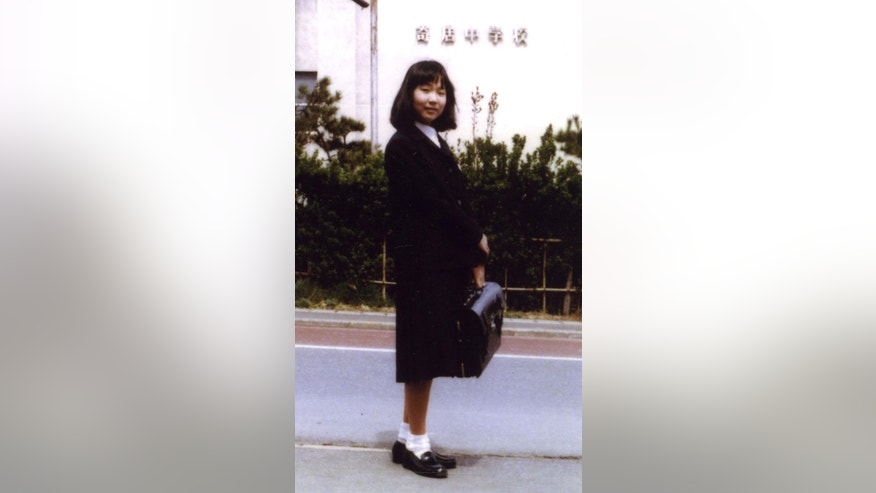 "In this photo taken in 1977 and released by National Association for the Rescue of Japanese Kidnapped by North Korea, Megumi Yokota, 13, stands in front of Yorii Junior High School in Niigata, northwestern Japan, before her abduction by North Korean agents. Yokota is one of the 12 that Japan says North Korea abducted in the 1970s and 80s. In talks with Japan in Beijing on Tuesday, July 1, 2014, North Korea is expected to detail plans to investigate what happened to them, a possible step toward their eventual repatriation to Japan. MISSING: Megumi Yokota, student, AGE WHEN ABDUCTED: 13, HER STORY: The symbol of Japan's abduction victims, Yokota is widely known for a photo of her in a navy blue school uniform standing under a row of cherry trees in full bloom. She never came home from badminton practice on Nov. 15, 1977, one day after giving her now-81-year-old father a comb on his birthday. A Japanese government website says she was confined in a dark compartment in a boat for nearly two days, crying ""mother"" and scratching the wall until her nails were nearly peeled off. (AP Photo/National Association for the Rescue of Japanese Kidnapped by North Korea)"