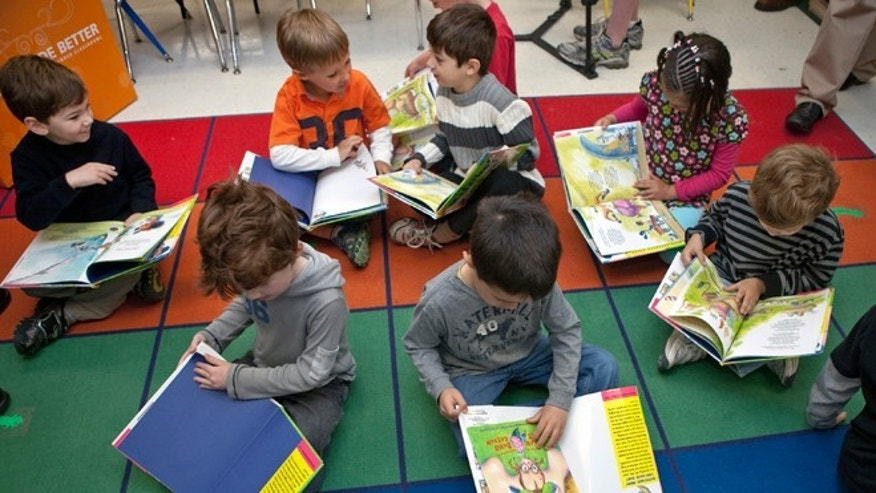 "WESTON, CT - APRIL 26:   Students in pre-kindergartner class enjoy reading a book by children's aiuthor Alan Katz during OfficeMax's ""A Day Made Better"" presentation at Hurlbutt Elementary School on April 26, 2010 in Weston, Connecticut in which $1,000 in school supplies were given to the class.   (Photo by Wendy Carlson/Getty Images for OfficeMax)"