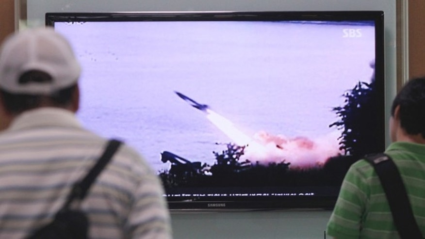 June 29, 2014: South Koreans watch a TV news program showing a missile launch conducted by North Korea, at Seoul Railway Station. North Korea fired two short-range missiles into its eastern waters Sunday, a South Korean official said, an apparent test fire that comes just days after the country tested what it called new precision-guided missiles. (AP Photo/Ahn Young-joon)