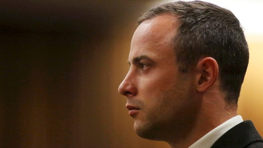 May 20, 2014: Oscar Pistorius listens as a court ruling is handed down that he would undergo psychiatric evaluation in Pretoria, South Africa. (AP Photo/Siphiwe Sibeko, Pool, File)