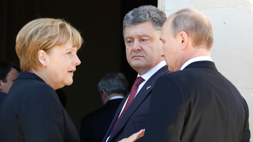 June 6, 2014 - FILE photo of Ukraine president Petro Poroshenko (center), German Chancellor Angela Merkel , and Russian President Vladimir Putin (right.) after a group photo for the 70th anniversary of the D-Day landings at Benouville Castle, France.