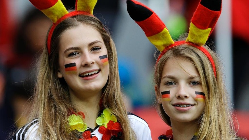 German supporters pose with their rabbit ears and face paint before the World Cup round of 16 soccer match between Germany and Algeria at the Estadio Beira-Rio in Porto Alegre, Brazil, Monday, June 30, 2014. (AP Photo/Kirsty Wigglesworth)