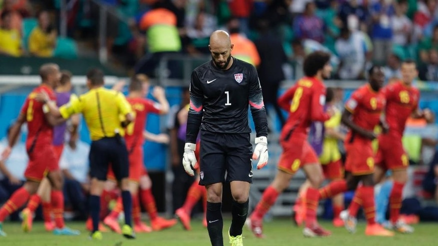 United States' goalkeeper Tim Howard reacts after Belgium's Kevin De Bruyne scored the opening goal during the World Cup round of 16 soccer match between Belgium and the USA at the Arena Fonte Nova in Salvador, Brazil, Tuesday, July 1, 2014. (AP Photo/Julio Cortez)