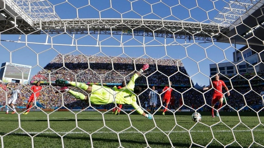 Switzerland's goalkeeper Diego Benaglio dives but can't stop a goal by Argentina's Angel di Maria in extra time during the World Cup round of 16 soccer match between Argentina and Switzerland at the Itaquerao Stadium in Sao Paulo, Brazil, Tuesday, July 1, 2014. (AP Photo/Victor R. Caivano)