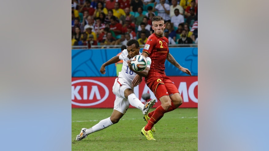 United States' Julian Green, left, scores his side's first goal during the World Cup round of 16 soccer match between Belgium and the USA at the Arena Fonte Nova in Salvador, Brazil, Tuesday, July 1, 2014. (AP Photo/Matt Dunham)