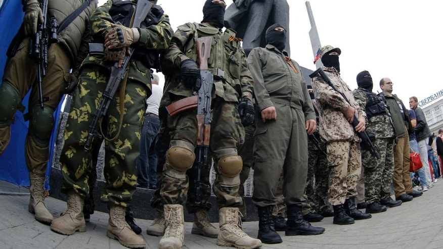 June 21, 2014: Pro-Russian fighters stand guard in Donetsk, eastern Ukraine.