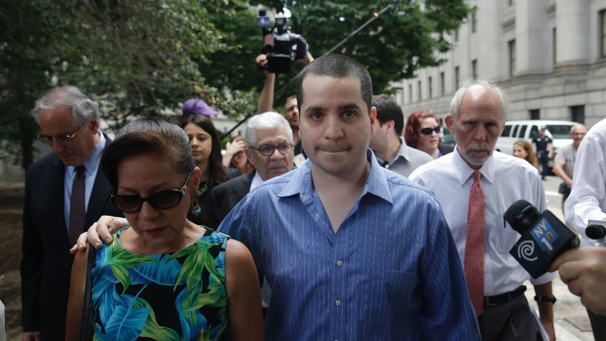 GIlberto Valle, front right, is surrounded by reporters as he leaves Manhattan federal court in New York, Tuesday, July 1, 2014. A federal judge has overturned the conviction of Valle, a former New York City police officer accused of plotting to kidnap, kill and eat young women. (AP Photo/Seth Weng)