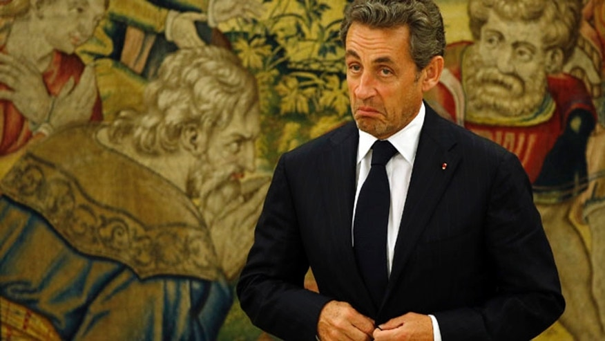 May 27, 2014: Former French President Nicolas Sarkozy reacts as he waits for the arrival of Spanish King Juan Carlos before their meeting at Zarzuela Palace outside Madrid.