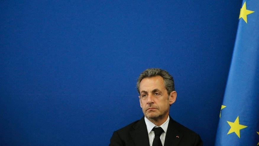 FILE - This March 10, 2014, file photo shows Former french President Nicolas Sarkozy during the inauguration of the Foundation Claude Pompidou in Nice, southeastern France. Former French President Nicolas Sarkozy has been detained and is reportedly being questioned by financial investigators in a corruption probe that is rattling France's conservative political establishment. (AP Photo/Lionel Cironneau, File)
