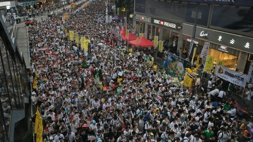 July 1, 2014: Tens of thousands of people fill in a street during a march at an annual protest in downtown Hong Kong.