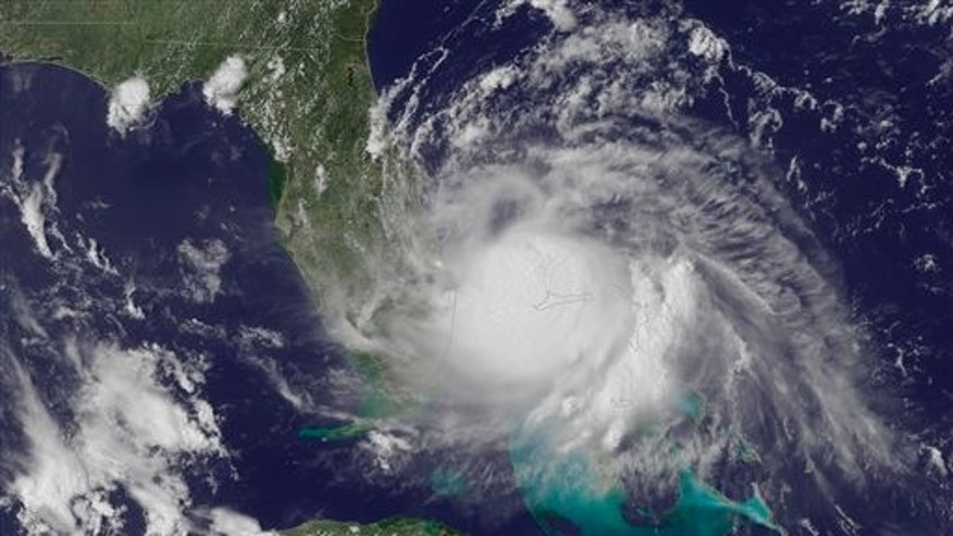 This Tuesday, July 1, 2014, satellite image released by the National Oceanic and Atmospheric Administration (NOAA), shows the center of Tropical Storm Arthur off the east coast of Florida. With the July Fourth weekend on the horizon, the Atlantic hurricane season's first named storm plodded off Florida's coast early Wednesday, though Tropical Storm Arthur wasn't yet spooking too many in the storm's potential path.