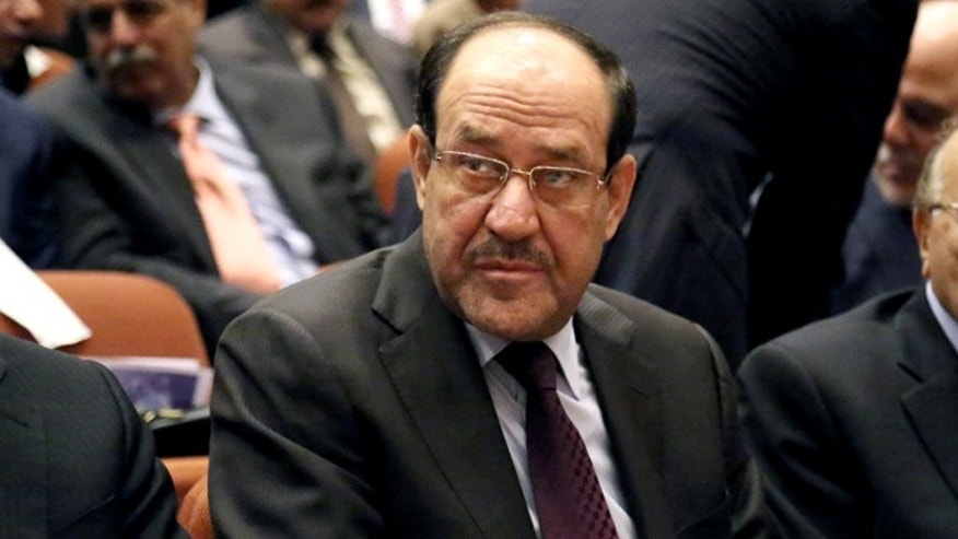 July 1, 2014: Iraqi Prime Minister Nouri al-Maliki, attends the first session of parliament in the heavily fortified Green Zone in Baghdad, Iraq. (AP)