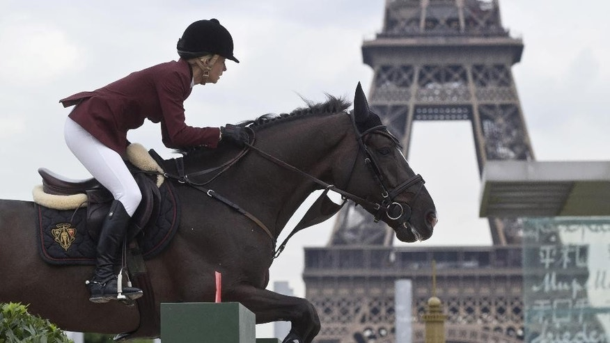 Australia's Edwina Tops-Alexander rides Ego van Orti, during the first day of the Eiffel  jumping horse show in Paris, Friday, July 4, 2014. Eiffel jumping takes place through this week-end at the Champs de Mars garden near the Eiffel Tower. (AP Photo/Michel Euler)