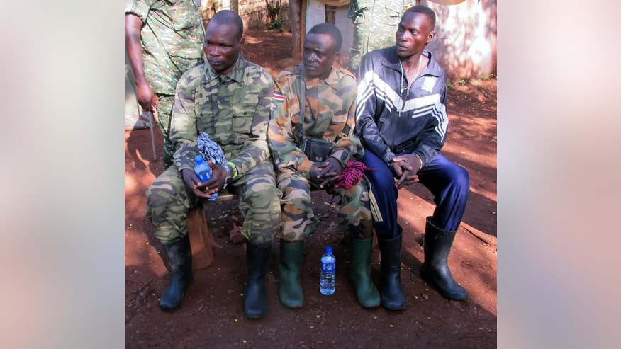 In this Wednesday, June 25, 2014 file photo, three defecting fighters from the Lord's Resistance Army rebel group, from left, Sam Opio, Richard Okello and Walube Ojok, sit down for a debriefing session in Central African Republic. The African troops hoped the latest defector from the Lord's Resistance Army rebel group would have something fresh to say about the possible whereabouts of the infamous warlord Joseph Kony. But Sam Opio, a senior rebel commander who defected last week, shook his head and said he hadn't seen rebel leader Kony since 2010. And he is not alone. All recent defectors have denied seeing or communicating with Kony in the last few years, complicating the work of U.S.-backed Ugandan troops who are hunting down rebels in the dense, often-impenetrable jungles of Central Africa. An Associated Press reporter recently trailed soldiers tracking a very small group of rebels. (AP Photo/Rodnet Muhumuza)