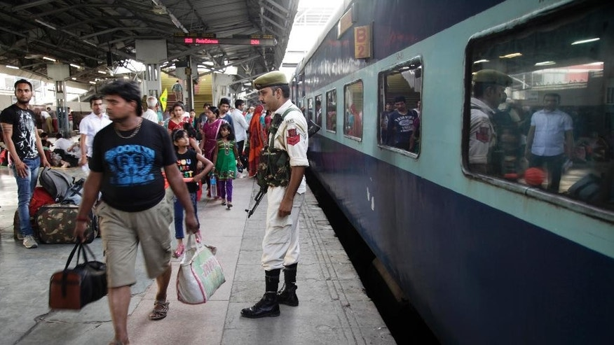A security officer keeps vigil at a railway station in Jammu, india, Thursday, July 3, 2014. Security has been beefed up ahead of Indian prime minister Narendra Modi's visit to the state of Jammu and Kashmir, Police said. (AP Photo/Channi Anand)