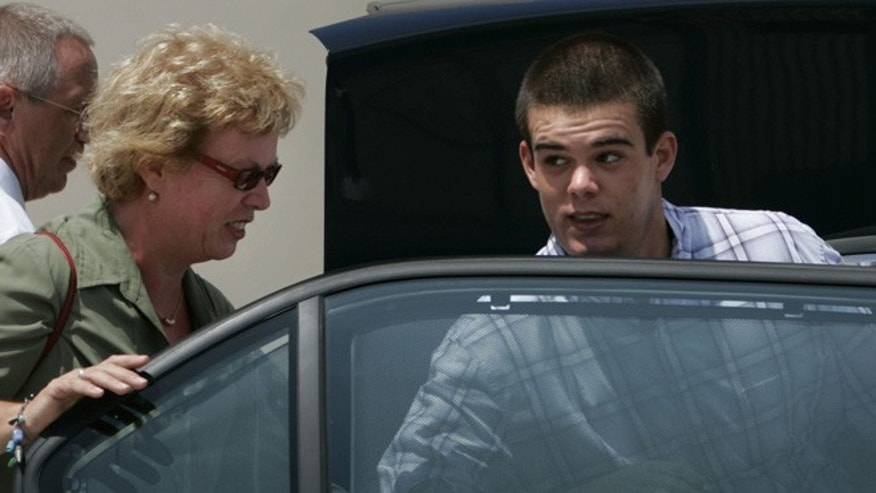 Sept. 3, 2005: Dutch teen Joran van der Sloot, 18, enters his family's car as his mother Anita closes the door after he was conditionally released from the KAI jail in San Nicolas, Aruba.