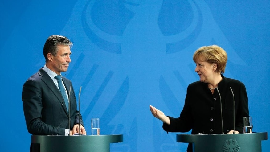 German Chancellor Angela Merkel, right, and NATO Secretary General Anders Fogh Rasmussen brief the media after a meeting at the chancellery in Berlin, Wednesday, July 2, 2014. (AP Photo/Markus Schreiber)