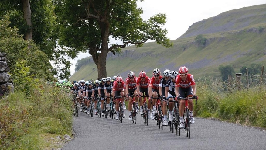 the pack rides during the first stage of the Tour de France cycling race over 190.5 kilometers (118.4 miles) with start in Leeds and finish in Harrogate, England, Saturday, July 5, 2014. (AP Photo/Christophe Ena)