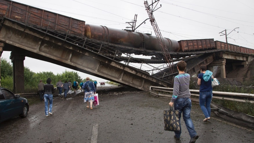 July 7, 2014 - A destroyed railroad bridge over a main road leading into the east Ukraine city of Donetsk. The bridge has been destroyed, blocking a key access route to the rebel-held city.