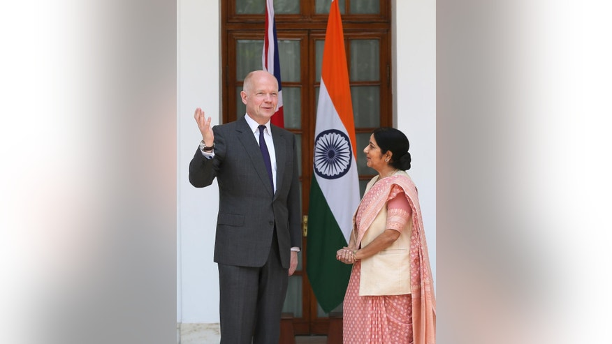 Indian Foreign Minister Sushma Swaraj, right, talks with British Foreign Secretary William Hague, in New Delhi, India ,Tuesday, July 8, 2014. (AP Photo /Manish Swarup)